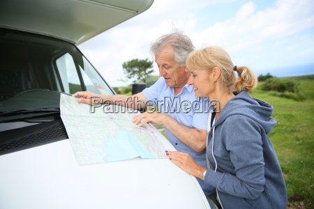senior people reading road map by
