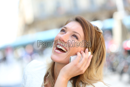 portrait of blond woman laughing on