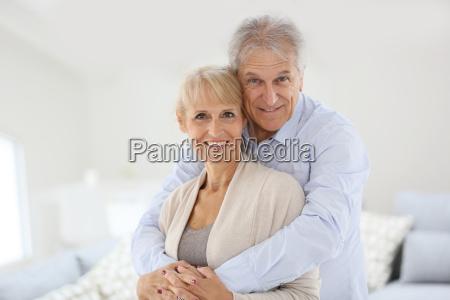 loving senior couple looking at camera
