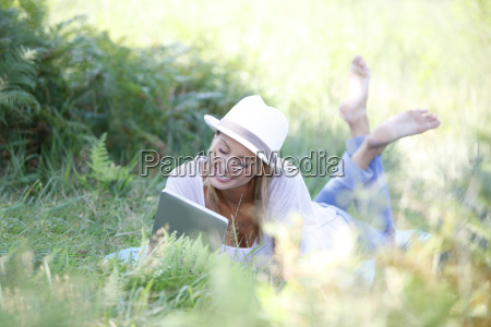 relaxed woman using digital tablet in