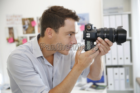 portrait of photographer taking pictures in