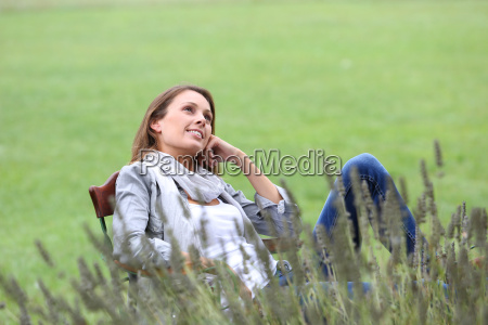 woman relaxing in chair in home