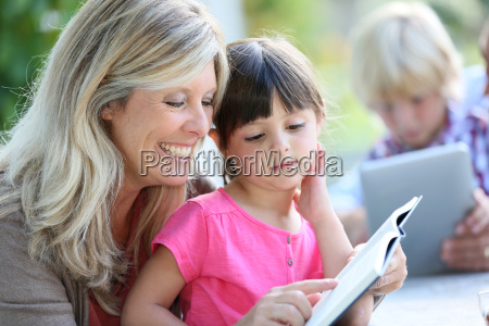 woman with daughter teaching how to