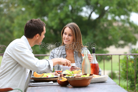 cheerful couple having lunch in hotel