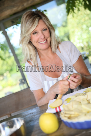 portrait of beautiful mature woman cooking