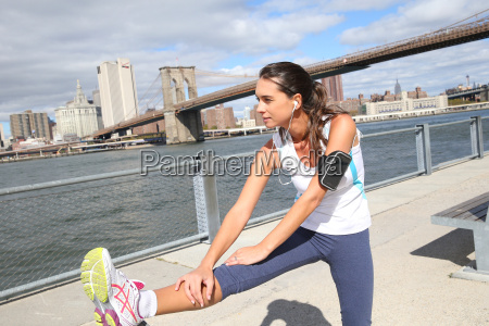 woman stretching out after running on
