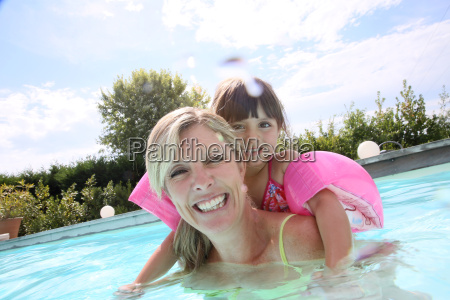 mother and daughter playing in swimming