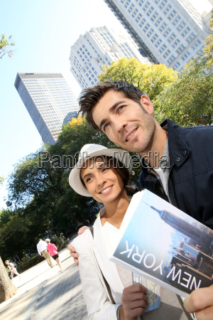 couple of tourists reading new york
