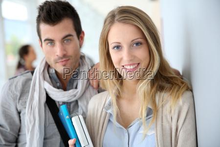 friends standing in university hallway