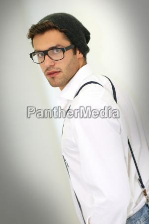 trendy guy with suspenders and eyeglasses