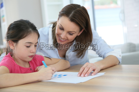school girl with mother learning to