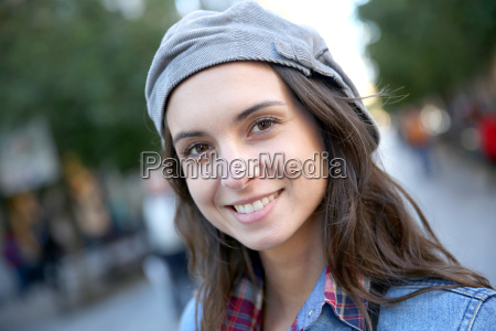 portrait of smiling woman in town
