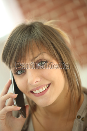 closeup of young woman talking on