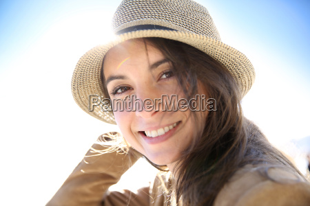 portrait of attractive woman wearing hat