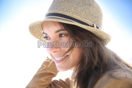 portrait of attractive woman wearing hat