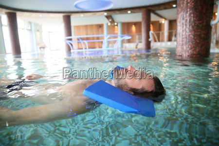 man in spa pool doing exercises