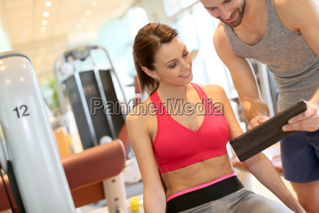 fitness girl with coach setting up