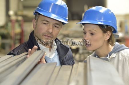 supplier with engineer checking on production