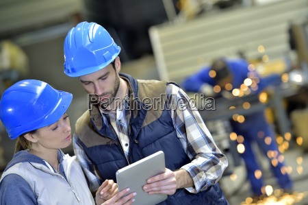 engineers in steel factory working on