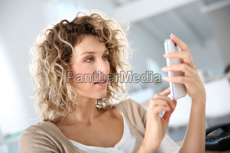 woman in office sending message with