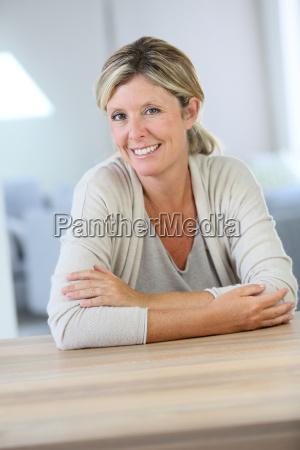 portrait of smiling confident woman sitting