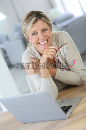 middle aged woman working on laptop