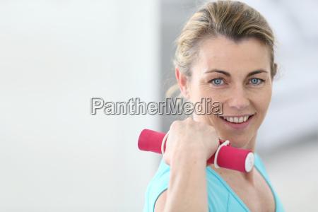 portrait of mature fitness woman lifting