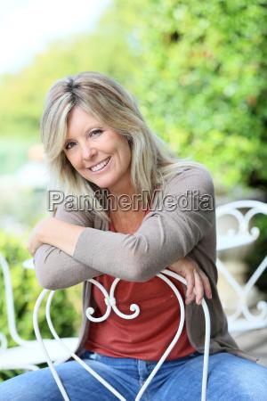 portrait of smiling mature blond woman
