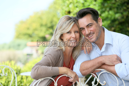 portrait of couple sitting in outdoor