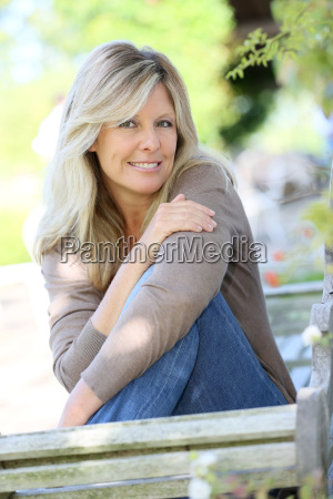 mature blond woman relaxing in outdoor