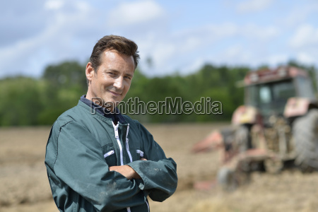 portrait of smiling farmer in cultivated