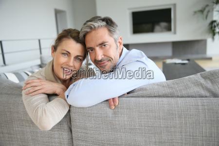 portrait of cheerful mature couple sitting