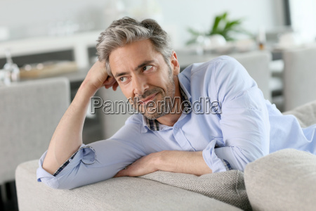 portrait of mature man relaxing in