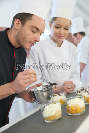 chef with student in pastry making