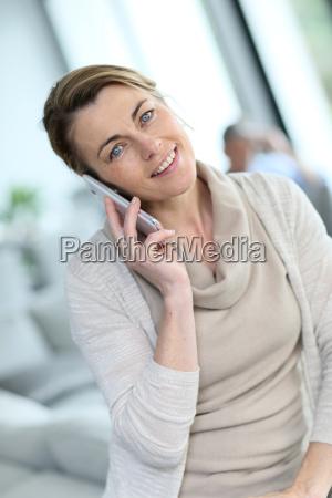 portrait, of, mature, blond, woman, talking - 17830052