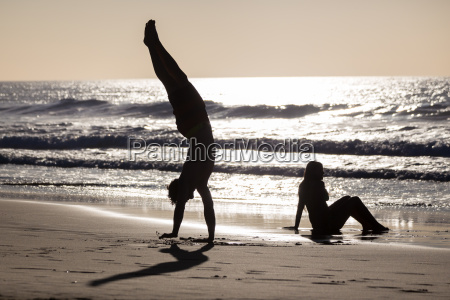 happy couple having fun on beach