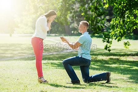 man making proposal to woman