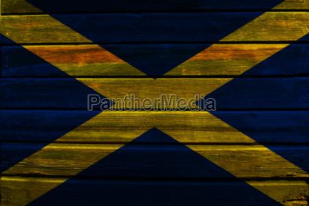 flag of scotland on wood
