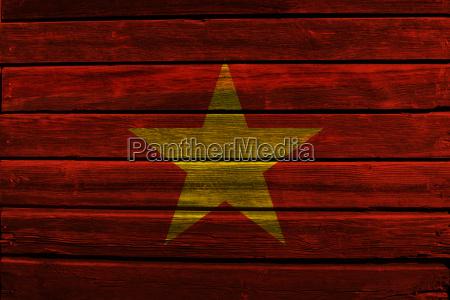 flag of vietnam on wood
