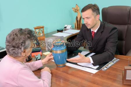 funeral director with woman looking at