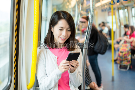 woman use of mobile phone in