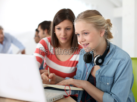 students girls studying together on laptop