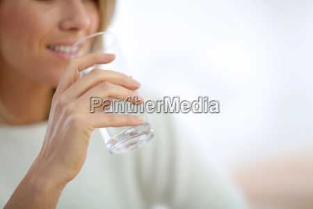 closeup on glass of water held