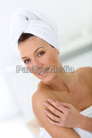 portrait of attractive woman in bathroom