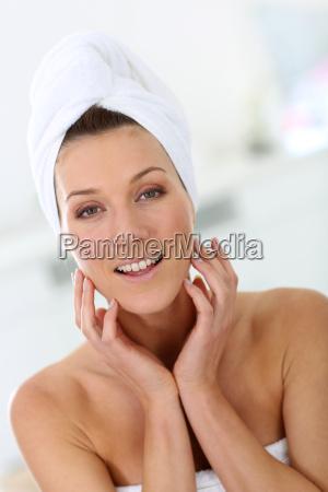 portrait of attractive woman in bathroom