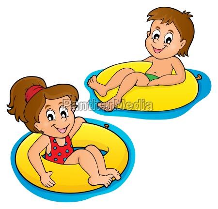 children in swim rings image 1