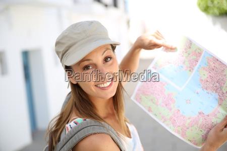 tourist girl holding city map