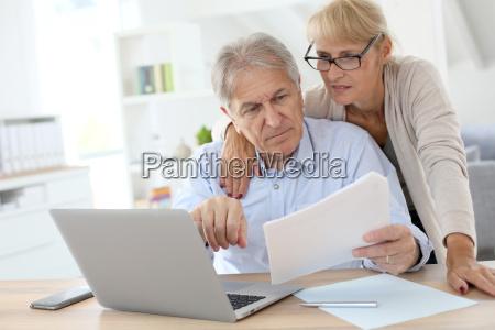 senior couple doing the income tax