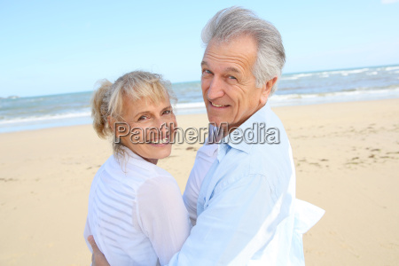 cheerful senior couple standing on the