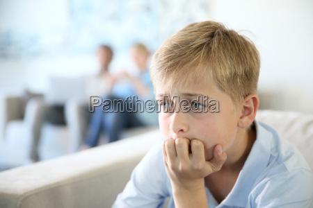 12 year old boy sitting in